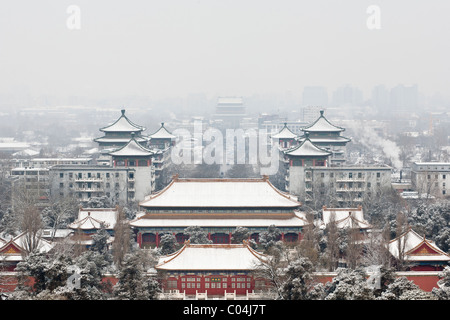 The Drum Tower (center) and the north gate of the Coal Hill (foreground) after a snowfall on Beijing. - Stock Photo
