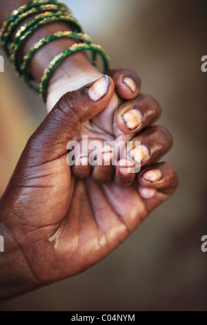 Mother washing her child hands Andhra Pradesh South India - Stock Photo