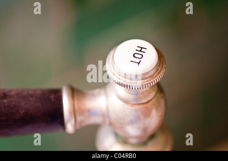 Old fashioned tap at a bathtub; altmodischer kran an einer badewanne - Stock Photo