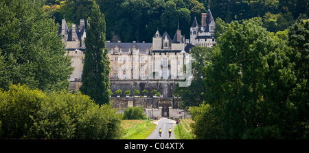 Cyclists at Chateau d'Usse at Rigny Usse from across the Indre River in the Loire Valley, France - Stock Photo