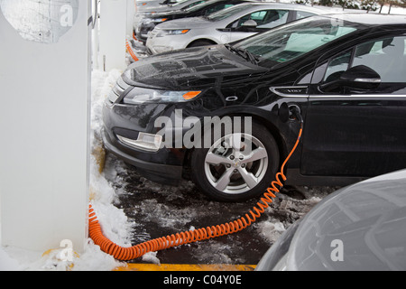 Chevrolet Volt Electric Cars Charging Outside the Factory Where They are Manufactured - Stock Photo