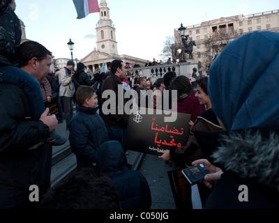 Egyptian and Palestinian demonstrators supporting Egypt's International Arab Spring revolution demo Trafalgar Square - Stock Photo