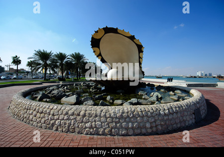 One of the famous sites on Al Corniche in Doha, Qatar, the giant shell called The Pearl Monument - Stock Photo
