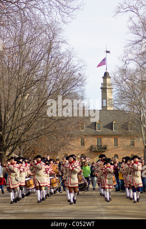 Fife and Drum Marching Band playing in front of the House of Burgesses Capital building in Historic Colonial Williamsburg, - Stock Photo