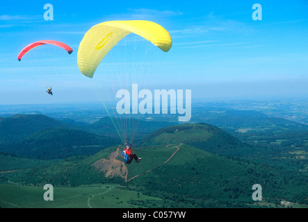 Hang gliding near the Puy de Dome volcano in Auvergne, France. - Stock Photo