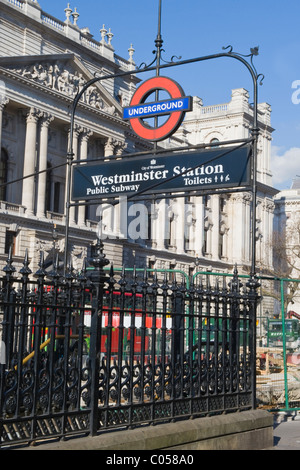London , Westminster , Westminster Underground , Metro or Tube Station entrance in Whitehall with red double decker - Stock Photo