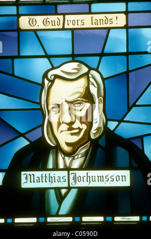 Stained glass window in the cathedral at Akureyri, Iceland showing Matthias Jochumsson, the writer of Iceland's - Stock Photo