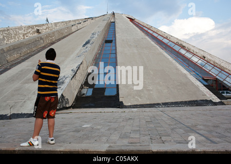 Enver Hoxha Mausoleum known as the Pyramid in Tirana. - Stock Photo