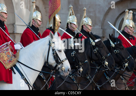 The Queen's lifeguards on horseback during 'changing of the guard' at horse guards parade, London, England. - Stock Photo