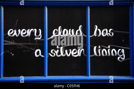 Every Cloud has a Silver Lining Message in Shop Window - Stock Photo