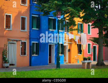 Colorful homes in Burano, an island in the Venetian Lagoon - Stock Photo