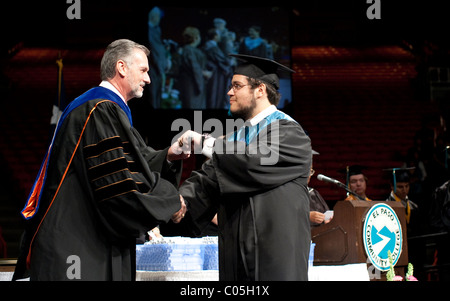 Teenage boy receives his diploma during graduation ceremony for Mission Early College High School in El Paso Texas - Stock Photo