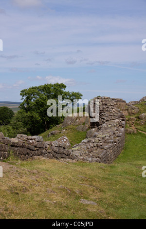 Hadrian's Wall heading East towards Cawfields near Walltown Crags in Brampton, Northumbria - Stock Photo
