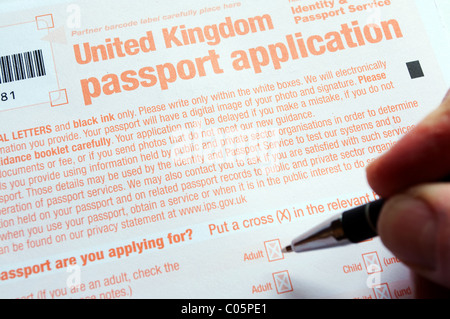 A United Kingdom passport application form being filled in - Stock Photo