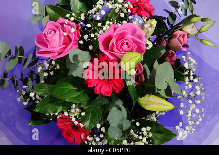 A bouquet of flowers delivered to the door. - Stock Photo