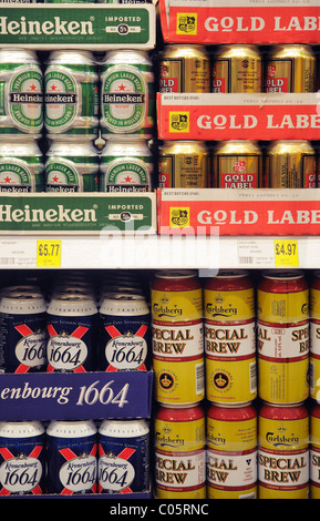 Tins of beer on a shelf in a supermarket in England - Stock Photo