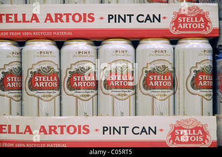 Cans of Stella on a shelf in a supermarket in England - Stock Photo
