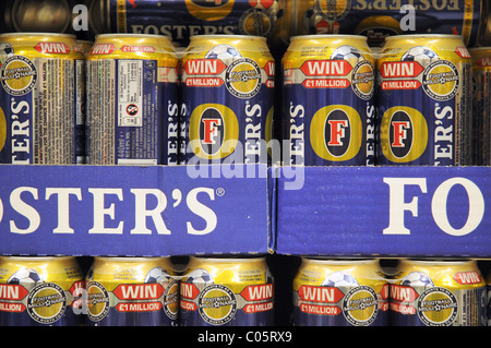Fosters lager on a shelf in a supermarket in England - Stock Photo