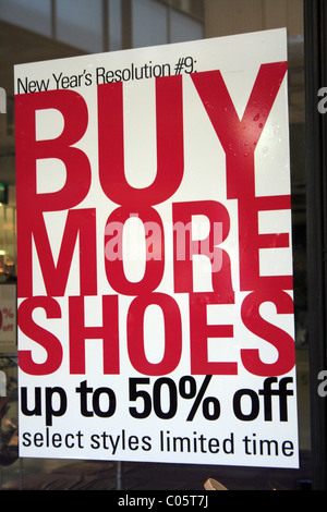 New Year sale sign in a shop window in Sydney, New South Wales, Australia - Stock Photo