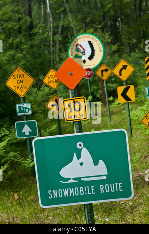 Snowmobile road signs in the Northwoods forests of Wisconsin. - Stock Photo