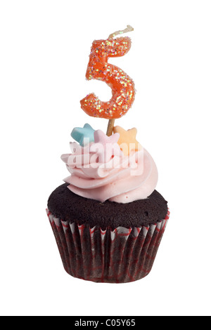 Mini cupcake with birthday candle for five year old isolated on white background - Stock Photo