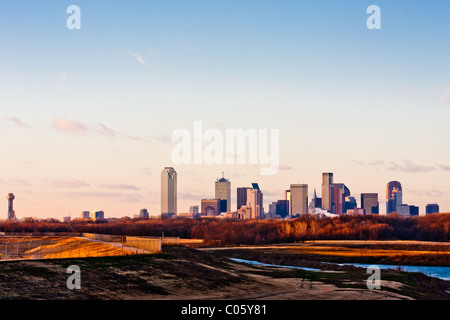 Wide angle view of the Dallas, Texas skyline from the south at the I-45 Interstate bridge over the Trinity River. - Stock Photo