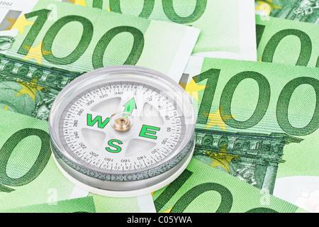 Euro banknotes and U.S. dollars - Stock Photo