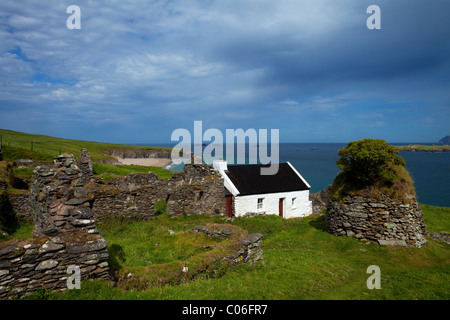 Cottage and Deserted Cottages on Great Blasket Island, Blasket Islands, Dingle Peninsula, County Kerry, Ireland - Stock Photo