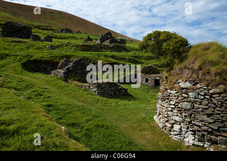 Deserted Cottages on Great Blasket Island, The Blasket Islands, Off Slea Head on the Dingle Peninsula, County Kerry, - Stock Photo