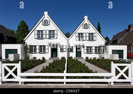 Two identical houses side by side, ready for moving in, Duesseldorf, North Rhine-Westphalia, Germany, Europe - Stock Photo