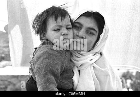 Young Palestinian Woman and Child, Bethany, (al-Eizariya), Jerusalem, Israel - Stock Photo