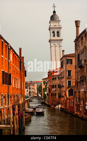 Side Canal Church Steeple Bridge Buildings Boats Reflections Venice Italy - Stock Photo
