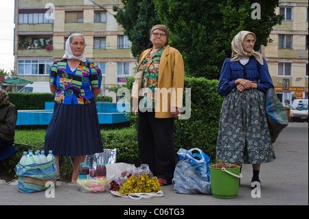 Women selling rural produce on the street in Cluj-Napoca, Romania. - Stock Photo