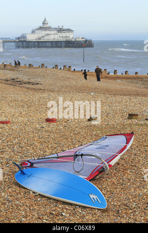 A windsurfing board on the beach at Eastbourne, East Sussex, England. - Stock Photo
