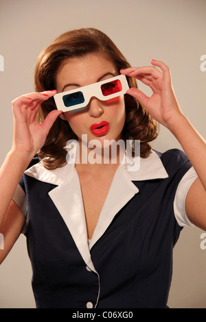 Woman wearing a pair of vintage 3D glasses - Stock Photo