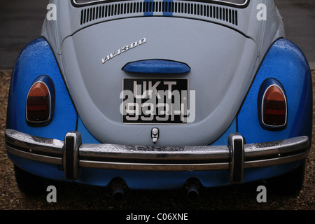 The rear end of a classic Volkswagen Beetle in a car park in Dorset in 2011 - Stock Photo