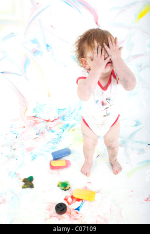 painted toddler in despair - Stock Photo