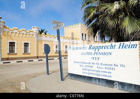 Old barrack and sign Princess Rupprecht Heim, architecture from the German colonial period, now Hostel, Swakopmund - Stock Photo