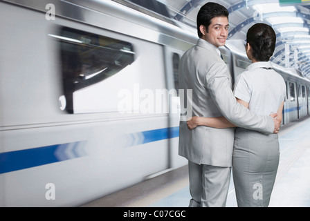 Business couple at a subway station - Stock Photo