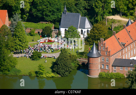 Aerial picture, open air church service on the occasion of the Feast of Corpus Christi, Herten palace gardens - Stock Photo
