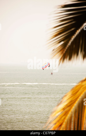 Person paragliding over the sea, Goa, India - Stock Photo