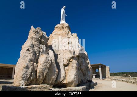 Virgin Mary statue on rock, Chapel Notre Dame de la Serra, Calvi, Balagne, Corsica, France, Europe - Stock Photo