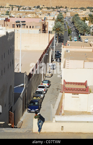 Algeria, Ghardaia, high angle view of vehicles parked in a row on alleyway surrounded by houses on both the side, - Stock Photo