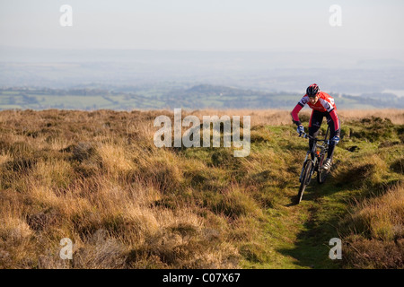 Man rides Mountain bike off road in United Kingdom - Stock Photo