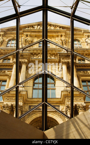 Museum viewed from the glass of a pyramid, Louvre Pyramid, Musee du Louvre, Paris, France - Stock Photo