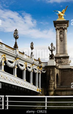 Lampposts on a bridge, Pont Alexandre III, Seine River, Paris, France - Stock Photo