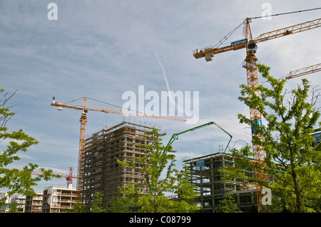 New construction of office buildings and apartments, construction phase, involving cranes, Am Arnulfpark district, - Stock Photo