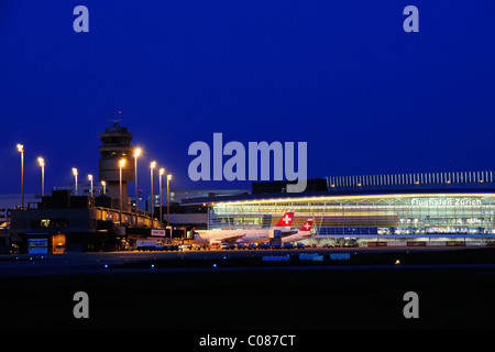 Zurich Airport and check-in hall for all passengers, Terminal A, with finger docks and the tower, Zurich, Switzerland, - Stock Photo