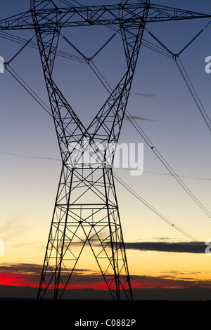 Electric transmission tower and sunset near Boise, Idaho, USA. - Stock Photo