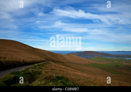 The Coomanaspig Pass, Overlooking Portmagee and distant Valentia Island, The Ring of Kerry, County Kerry, Ireland - Stock Photo